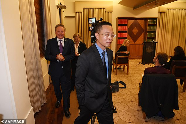 Chinese official who gatecrashed meeting was a cyber spy for Beijing